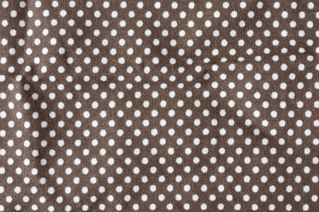 white dots on brown fabric Stock fotó