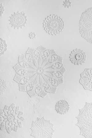 doilies: blurry crocheted doilies on white wall