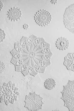doilies: doilies on wallpaper Stock Photo