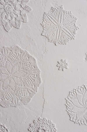 doilies: wall with crocheted doilies Stock Photo