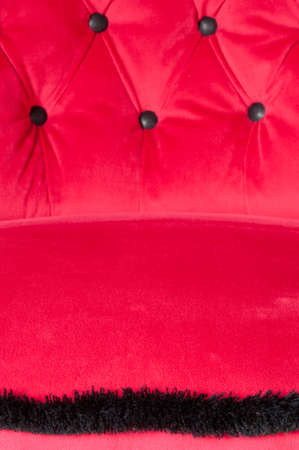 fringes: red chair in theater, close up