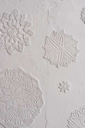 doilies: crocheted doilies in gesso on wall