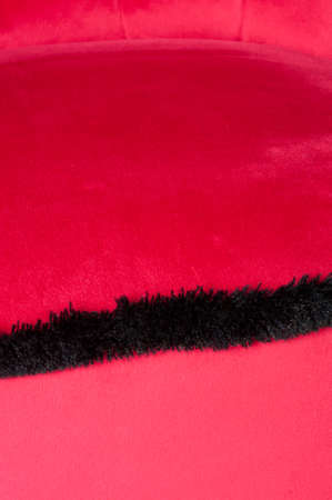fringes: red velvet and black fringes, detail Stock Photo
