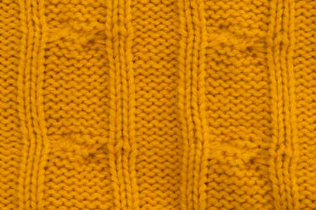 cable stitch: yellow cable stitch pattern, back side