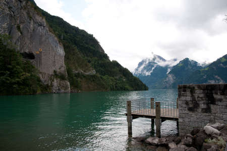 landing stage at a mountain lake in swiss photo