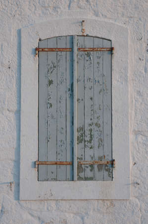 blue hour: wooden window shutters in blue hour