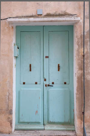 frontage: light blue old entrance door, frontage Stock Photo