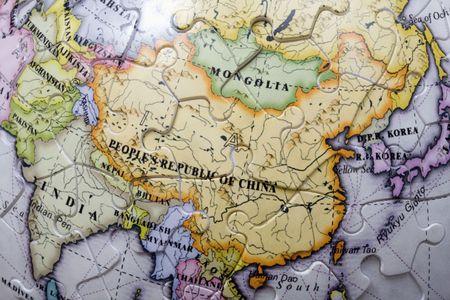 A world globe with the spotlight on China.