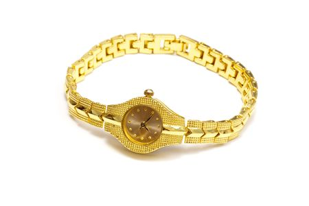 Woman gold wrist watch on white photo