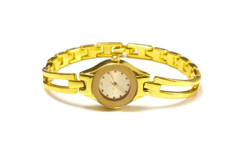 Woman gold wrist watch on white photo
