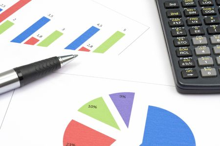 Business graph, a calculator and a pen