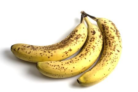 three spoiled bananas isolated on white background photo