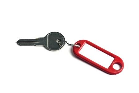 doorkey: Tag vuoti e una chiave isolata on white