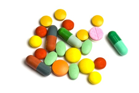 Colorful pills isolated on white background   photo