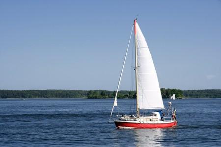 A Samll sailing boat in blueand calm sea Stock Photo - 7186732