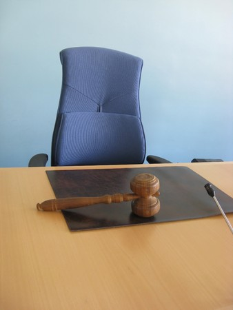 juror: Old wooden gavel,blue chair and court desk