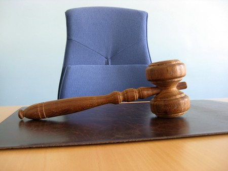 juror: Old wooden gavel ,blue chair and court desk