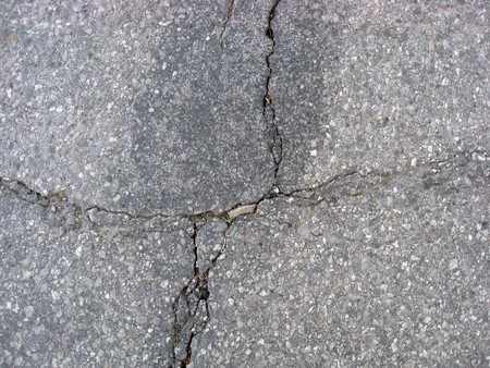 Texture of cracks on asphalt background  Stock Photo - 7560746