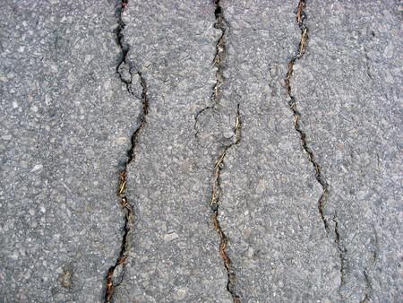 Texture of cracks on asphalt background  Stock Photo - 7560761