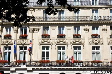 Apartments with beautiful flowers in balcony closeup in Paris photo