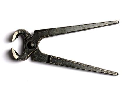 Old black tongs isolated on white background photo