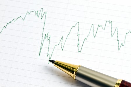 Analyzing the stock market with golden pen photo