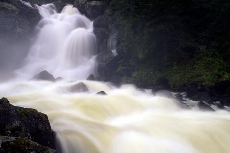 Big waterfall in mountain photo