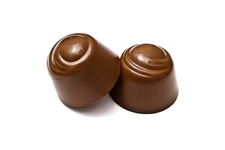 Delicious chocolates isolated on white background