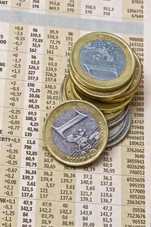 financial newspaper: Euro coins on a financial newspaper closeup