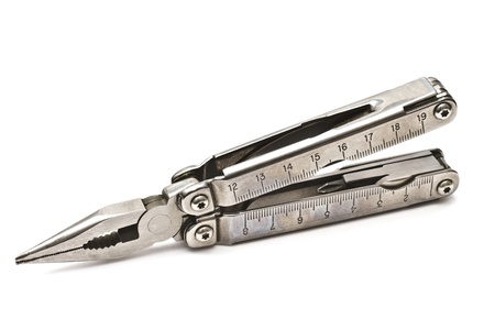Multi-tool isolated on white background photo