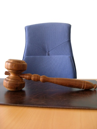 Old wooden gavel ,blue chair and court desk  photo
