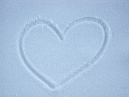 Snow background with heart shape photo