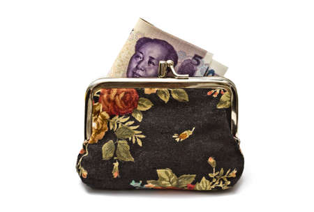 Chinese money in beautiful purse isolated on white background photo