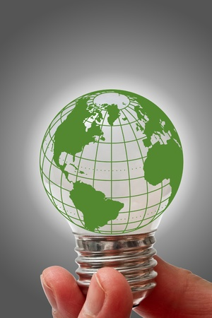 Light bulb with globe hold in hand photo