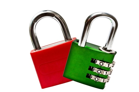 Red and green padlock isolated on white background photo