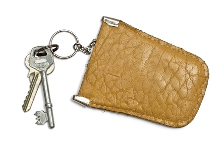 Keys and  leather tag isolated on white background  photo