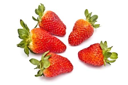 Fresh strawberries closeup on white background  photo