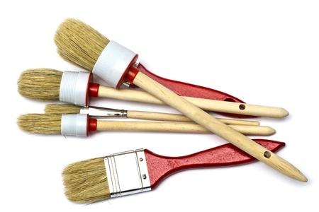 Different size paintbrushes closeup on white photo
