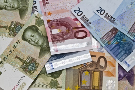 Chines money and euro currency closeup photo