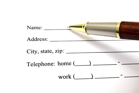 Pen isolated on a blank signature paper Stock Photo - 10025717