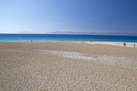 Beautiful landscape of blue ocean,sky and white sand beach photo