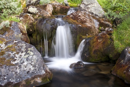 Beautiful mountain stream and rocks closeup photo
