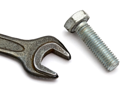 threaded: Wrench and bolt closeup on white background