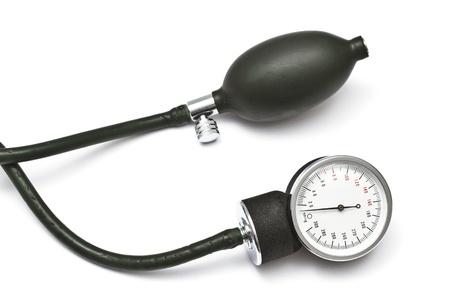 Old sphygmomanometer closeup on white background  photo