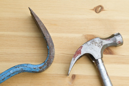 Old hammer and other tool on wood background   photo