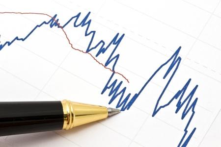 economia: Fondo de negocio gr�fico y una pluma