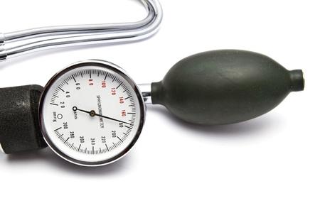 blood pressure bulb: Sphygmomanometer closeup on white background   Stock Photo