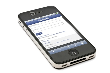 Facebook website display on iPhone 4s screen Stock Photo - 11542341