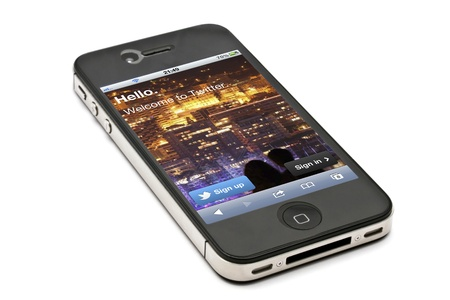 worldwide website: Twitter website display on apple iphone 4s screen Editorial
