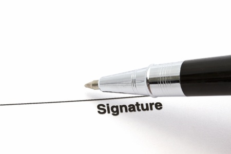 Pen isolated on a blank signature paper Stock Photo - 11656779